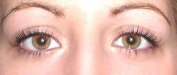 A woman after receiving Permalash eyelash and eyebrow makeup treatment